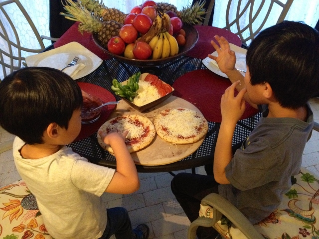 Making their own pizzas